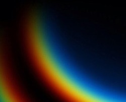 Photography of rainbow. Rainbow on black background.  Abctract web background. Banners and panels. Design background. Computer. Desktop background and design. Unique. Surrealistic. Dispersion of light