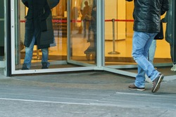 Photography of revolving office door entrance of modern Moscow International Business Center (MIBC). Business people coming. Business concepts and lifestyles. Low angle view