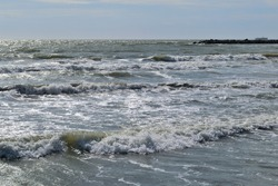 Photography of the wavy sea at the most popular beaches of Mar del Plata City during the summer vacation