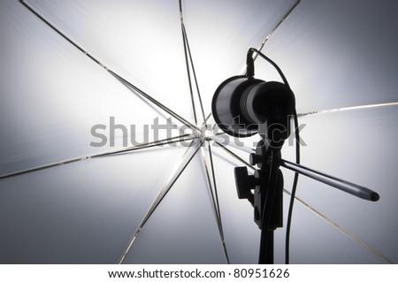 Photography set up with umbrella reflecting modeling lamp