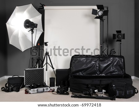 Photography Setup with Lights, Stands, Cameras, Bags and Backdrop