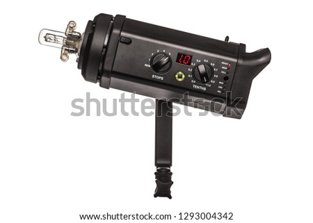 Photography studio flash, strobe, lamp or light. Aka monobloc or monolight. Used primarily in studios but also used on location with the aid of power packs. Isolated on 255 white background. #1293004342