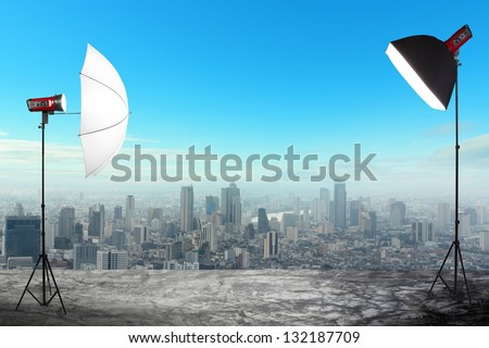 photography studio with a light set up on city buildings backdrop, Space for text or image