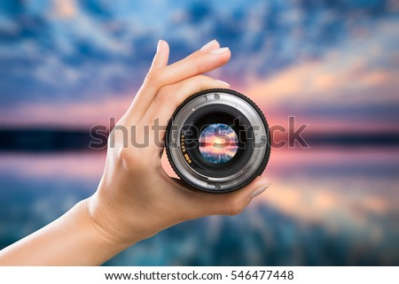 photography view camera photographer lens lense through video photo digital glass hand blurred focus people sun sunset sunrise cloud sky water lake concept - stock image #546477448