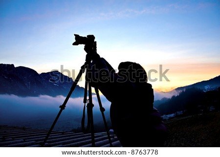 Photogrpher working at sunrise (shadow)