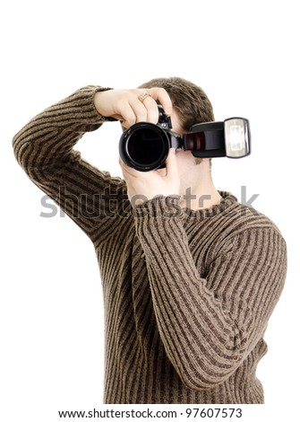 Photojournalist holding camera with flash. Isolated on white.