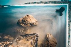 Photomanipulation of sea creating surreal waterfall