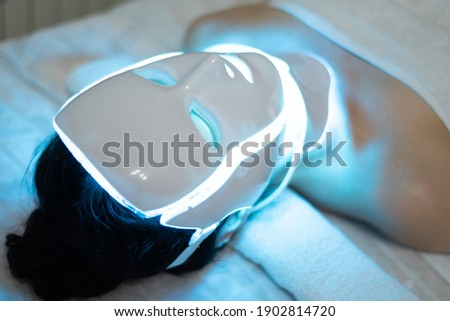 photon mask. Health and beauty. Cosmetic procedure for woman face. Beauty laboratory. LED Facial Mask, Photon Therapy. Photo shows the different modes, colors Сток-фото ©