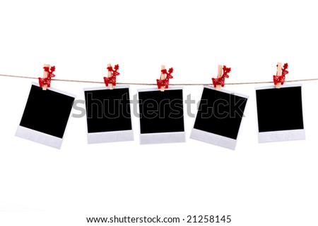 Photos frames with christmas ornaments isolated on white background
