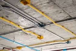 Photos of electrical systems in building construction. Installation of conduits in buildings.Conduit system in building under construction.