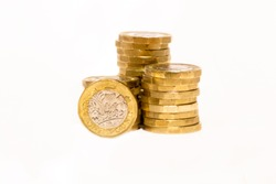Photos of Golden Stacks of GBP Coins on white background with empty space