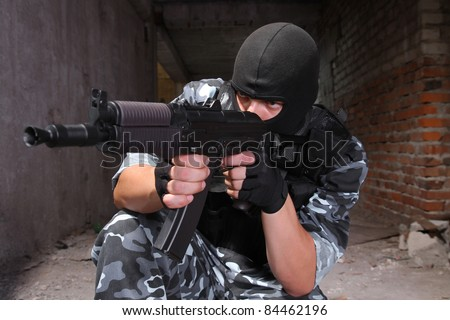 Photos of heavy equiped soldiers or terrorists in black masks with automatic guns.