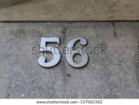 photos of house numbers, numbers of doors, fences rooms, rooms gables of houses in a small town near Barcelona, Spain.