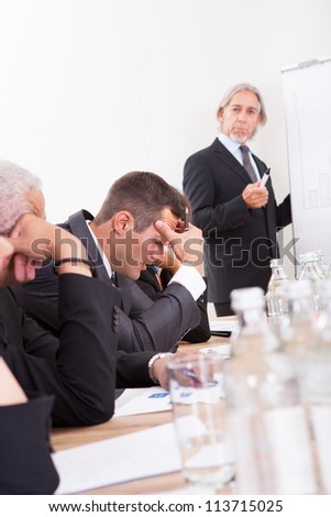 Photos Of Sad Business Team Attending The Seminar