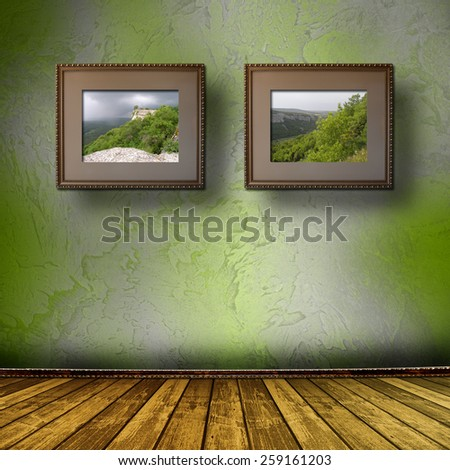 Photos of the Crimea in the old wooden frame on the wall