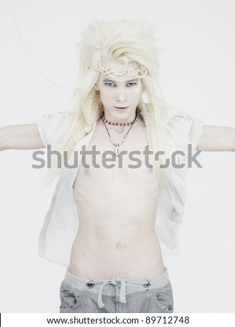 Photos of young handsome elf on a white background - stock photo