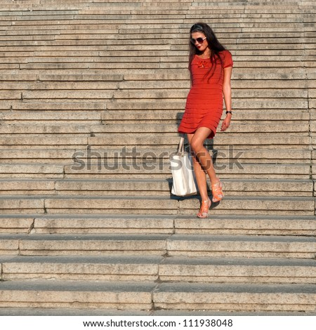Photos pretty girl walking on the big stairs