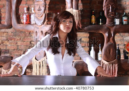 Photoshot of beautiful barmaid waiting order