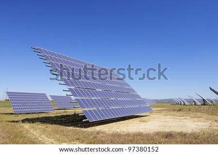 photovoltaic panels for renewable electrical energy production with clear blue sky