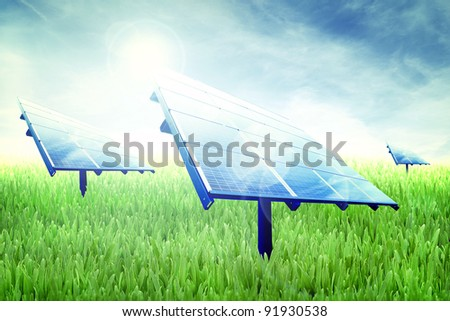 Photovoltaic panels in a green field of grass