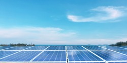 Photovoltaic panels installed on the roof of the building, seascape background.