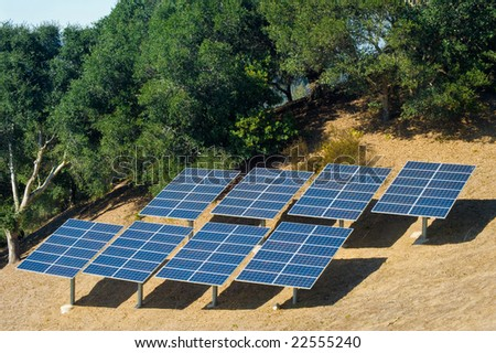 Photovoltaic panels used to power a rural home. - stock photo