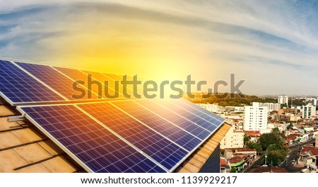 Photovoltaic power plant on the roof of a residential building on sunny day - Solar Energy concept of sustainable resources #1139929217
