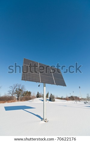 Photovoltaic solar panel array in a park in winter.