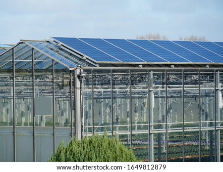Photovoltaic solar panels installed on a greenhouse in the Netherlands. ストックフォト ©