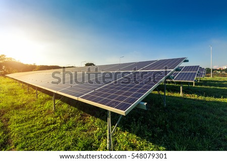 photovoltaic solar power panel on sky background, green clean Alternative power energy concept. Stockfoto ©