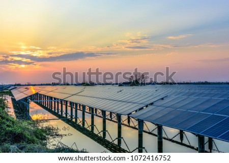 Photovoltaic solar power plant at sunset #1072416752