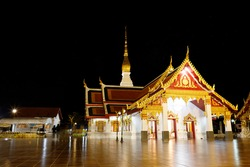 Phra That Choeng Chum temple at night is a major and sacred religious monument of Sakon Nakhon Province of Thailand.