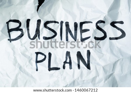 """Phrase """"business plan"""" handwritten on crumpled torn paper. Sign, concept of failed plans or poor management, abstract illustrative image #1460067212"""