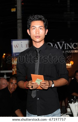 PHUKET - NOVEMBER 28: Guests at Black Is Back, a show in aid of the charity Life Home Project Phuket and the Sunshine Village Yacht Association on November 28, 2010 in Phuket, Thailand.