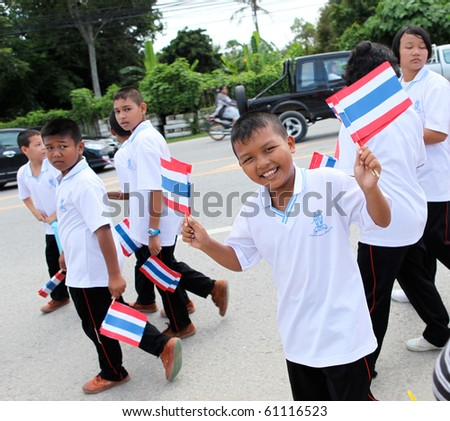 stock photo : PHUKET - SEPTEMBER 16: unidentified students during a parade marking the birthday of monk  Luang Pu Supha who is 114 on September 16, 2010 in Phuket, Thailand. Many Thais believe he is the world's oldest man.