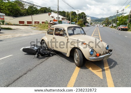 PHUKET, THAILAND - DECEMBER 17 : Car accident on the road and crashed with motorcycle which causing the rider serious injury. December 17, 2014 in Phuket Thailand.