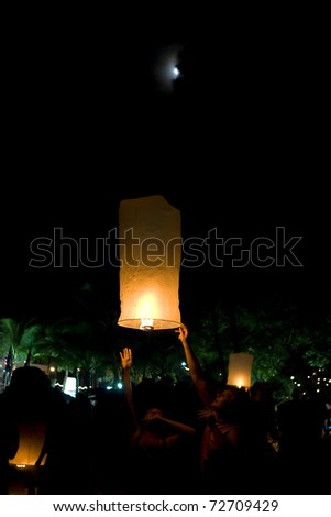 PHUKET, THAILAND - NOV 12: People hold a flying fire lantern to celebrate the Loy Krathong festival, a practice of paying respect to the spirit of the waters. November 12, 2008 in Phuket, Thailand.