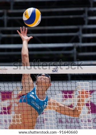 PHUKET, THAILAND - NOVEMBER 2: Kristina Valias of Canada in action during a match on day 2 of the SWATCH FIVB World Tour 2011 on November 2, 2011 at Karon Beach in Phuket, Thailand