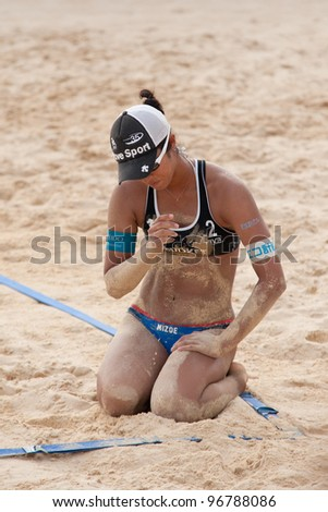 PHUKET, THAILAND - NOVEMBER 2: Sayaka Mizoe of Japan reacts after losing a point during a match on day 2 of the SWATCH FIVB World Tour 2011 on November 2, 2011 at Karon Beach in Phuket, Thailand