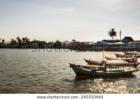 PhuQuoc, Vietnam - November 1st, 2013: These small boats were anchoring in harbor at sunset in HamNinh harbor, PhuQuoc, Vietnam
