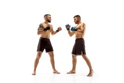 Phychology pressing. Two professional fighters posing isolated on white studio background. Couple of fit muscular caucasian athletes or boxers fighting. Sport, competition and human emotions concept.