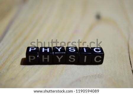Physic written on wooden blocks. Inspiration and motivation concepts. Cross processed image on Wooden Background