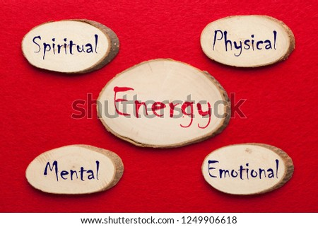 Physical, Emotional, Mental and Spiritual words written on wooden ellipses. Manage Your Energy Stock foto ©