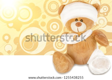 Physical Injured Teddy Bear isolated on white #1255438255