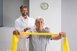 Physical Therapy Patient Using Physiotherapy Bands For Rehabilitation