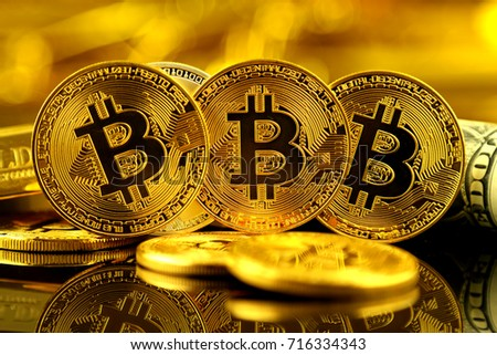 Physical version of Bitcoin (new virtual money) and banknotes of one dollar. Exchange bitcoin for a dollar. Conceptual image for worldwide cryptocurrency and digital payment system. #716334343
