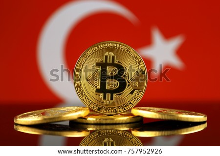 Physical version of Bitcoin (new virtual money) and Turkey Flag. Conceptual image for investors in cryptocurrency and Blockchain Technology in Turkey.