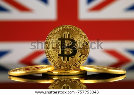 Physical version of Bitcoin (new virtual money) and UK Flag. Conceptual image for investors in cryptocurrency and Blockchain Technology in United Kingdom.