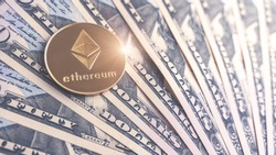 Physical version of Ethereum and dollar banknotes. Exchange eth for a dollar symbol. Conceptual image for worldwide cryptocurrency and digital payment system.
