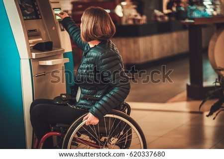 Physically challenged woman near ATM . Stock photo ©